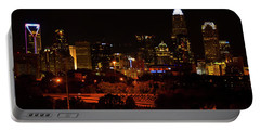 Portable Battery Charger featuring the digital art The City Of Charlotte Nc At Night by Chris Flees