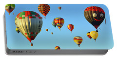 Portable Battery Charger featuring the photograph The Crowded Skies by AJ Schibig