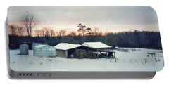The Farm In Snow At Sunset Portable Battery Charger