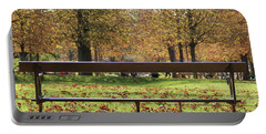 Portable Battery Charger featuring the photograph The French Bench And The Autumn by Yoel Koskas