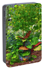 Portable Battery Charger featuring the photograph The Garden by Kathy Baccari