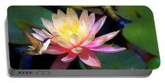 Portable Battery Charger featuring the photograph The Grutas Water Lillie With Hummingbirds by John Kolenberg