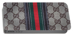 The Gucci Monograms Portable Battery Charger