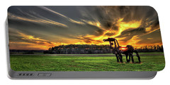 Portable Battery Charger featuring the photograph The Iron Horse Sunset by Reid Callaway