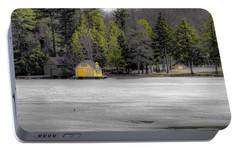 Portable Battery Charger featuring the photograph The Lighthouse On Frozen Pond by David Patterson