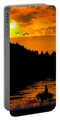 Portable Battery Charger featuring the photograph The Lonesome Cowboy by Diane Schuster