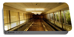 Portable Battery Charger featuring the photograph The Long Hall by Eric Christopher Jackson