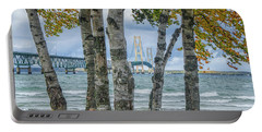 The Mackinaw Bridge By The Straits Of Mackinac In Autumn With Birch Trees Portable Battery Charger