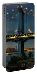 Portable Battery Charger featuring the photograph The Manhattan Bridge During Blue Hour by Chris Lord