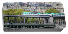 Portable Battery Charger featuring the photograph The Metro On The Bridge by Yoel Koskas