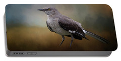 Portable Battery Charger featuring the photograph The Mockingbird A Bird Of Many Songs by David and Carol Kelly