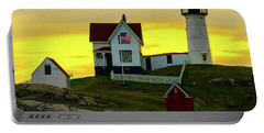 Portable Battery Charger featuring the photograph The Nubble Cape Neddick Lighthouse In Maine At Dawn by Chris Lord