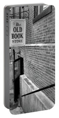 Portable Battery Charger featuring the photograph The Old Book Store by Karol Livote
