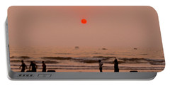 Portable Battery Charger featuring the photograph The Orange Moon by Sher Nasser