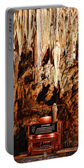 Portable Battery Charger featuring the photograph The Organ In The Cavern by Paul Ward