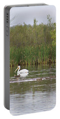 Portable Battery Charger featuring the photograph The Pelican And The Ducklings by Alyce Taylor