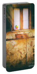 Portable Battery Charger featuring the photograph The Pinwheel by Silvia Ganora