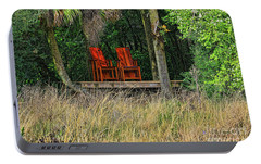 Portable Battery Charger featuring the photograph The Red Chairs by Deborah Benoit