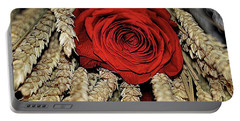 Portable Battery Charger featuring the photograph The Red Rose On A Bed Of Wheat by Diana Mary Sharpton