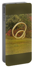 Portable Battery Charger featuring the photograph the rings of Mactown by Aaron Martens