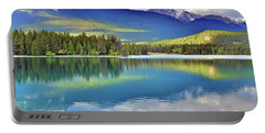 Portable Battery Charger featuring the photograph The Rockies Reflected In Lake Annette by Tara Turner
