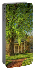 Portable Battery Charger featuring the photograph The Stone Cottage On A Spring Evening by Lois Bryan