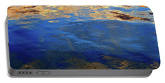 The Surface Is A Reflection  Portable Battery Charger by Lyle Crump