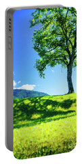 Portable Battery Charger featuring the photograph The Tree On The Hill by Silvia Ganora