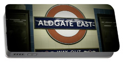 Portable Battery Charger featuring the photograph The Tube Aldgate East by Christin Brodie