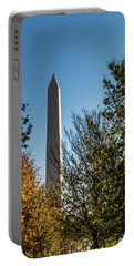 The Washington Monument In Fall Portable Battery Charger