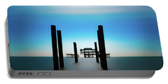 Portable Battery Charger featuring the photograph The West Pier Ruins In Winter Light by Chris Lord