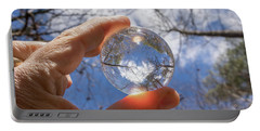 The World In My Hand Portable Battery Charger by Wade Brooks