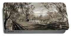 Portable Battery Charger featuring the photograph The Yards by Linda Lees