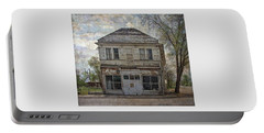 Portable Battery Charger featuring the photograph This Old Store by Thom Zehrfeld