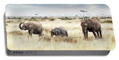 Three Elephants Walking In Kenya Africa Portable Battery Charger