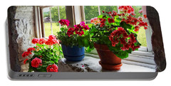 Three Pots Of Geraniums On Windowsill Portable Battery Charger