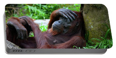 Tired Female Orangutan Ape Rests Against Tree With Hand On Her Head Portable Battery Charger