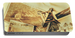 Toned Image Of Eiffel Tower And Photographs On Table Portable Battery Charger