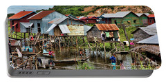 Tonle Sap Boat Village Cambodia Portable Battery Charger by Chuck Kuhn