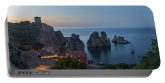 Portable Battery Charger featuring the photograph Tonnara And Faraglioni Rocks In Scopello At Dusk by IPics Photography