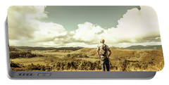 Tourist With Backpack Looking Afar On Mountains Portable Battery Charger