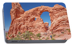 Portable Battery Charger featuring the photograph Tourists On Sandstone Arch Formation, Arches National Park by A Gurmankin