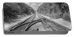 Portable Battery Charger featuring the photograph Tracks 2 by Mike McGlothlen