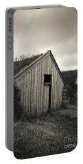 Portable Battery Charger featuring the photograph Traditional Turf Or Sod Barns Iceland by Edward Fielding