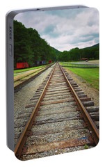 Portable Battery Charger featuring the photograph Train Tracks by Linda Sannuti