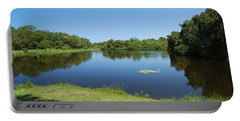 Portable Battery Charger featuring the photograph Tranquil Lake by Gary Wonning