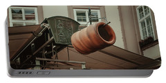 Portable Battery Charger featuring the photograph Trdelnik. Prague Architecture by Jenny Rainbow
