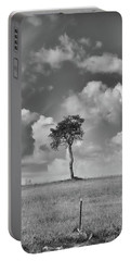 Portable Battery Charger featuring the photograph Tree In A Field by Guy Whiteley