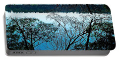 Portable Battery Charger featuring the photograph Tree Overhang Reflected In The Water by Joy Nichols