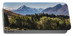 Portable Battery Charger featuring the photograph Tree View Of Mt Cook Aoraki by Gary Eason